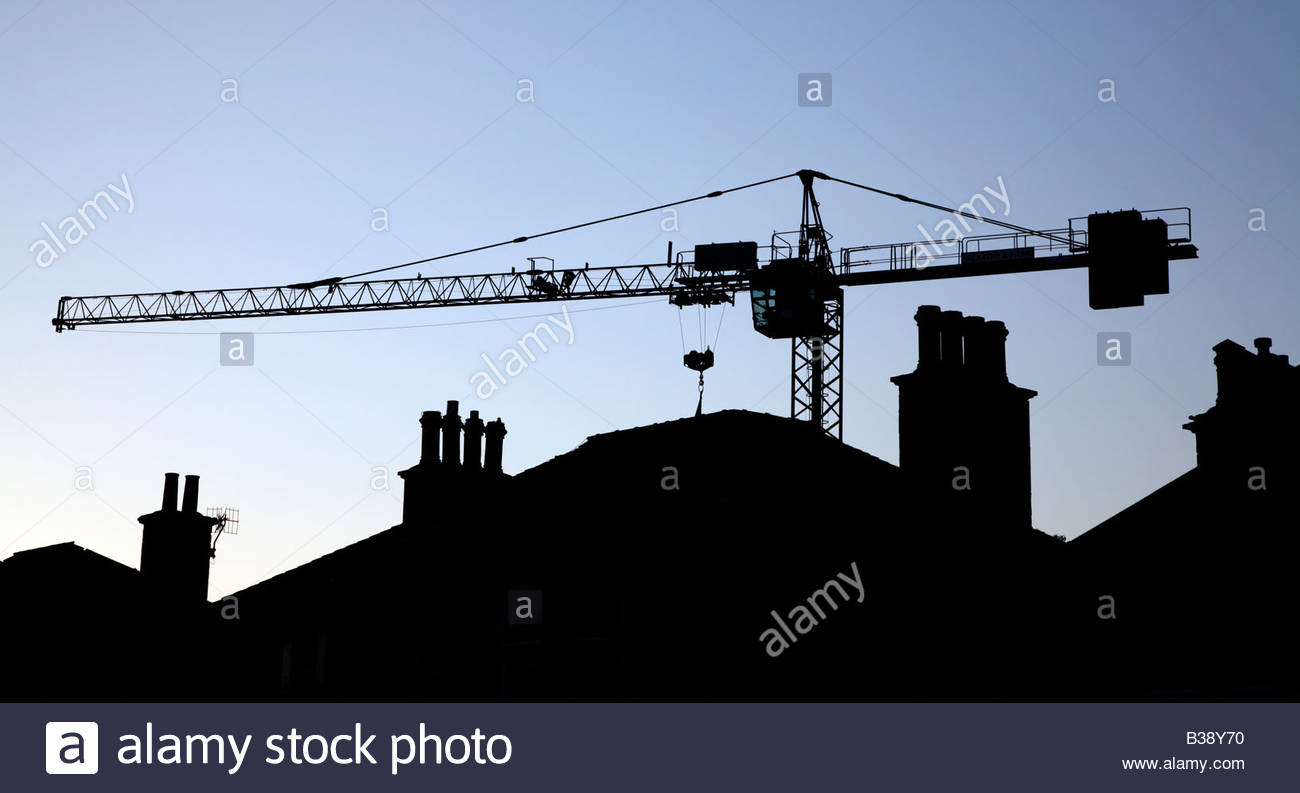 Crane silhouetted at dusk - Stock Image