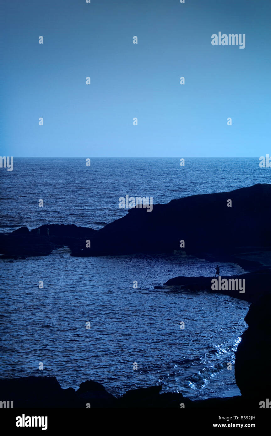 Lone person on rocky outcrop, Santa Cruz, California - Stock Image