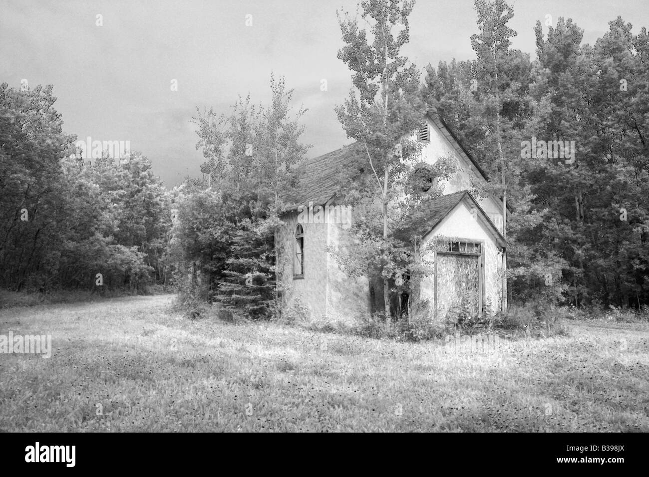 Abandoned old church in Manning area (infra effect), Alberta - Stock Image