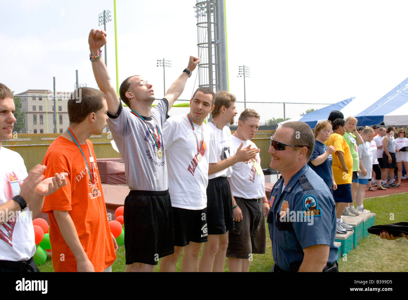 Exuberant athlete wearing 1st place medal. Special Olympics U of M Bierman Athletic Complex. Minneapolis Minnesota - Stock Image