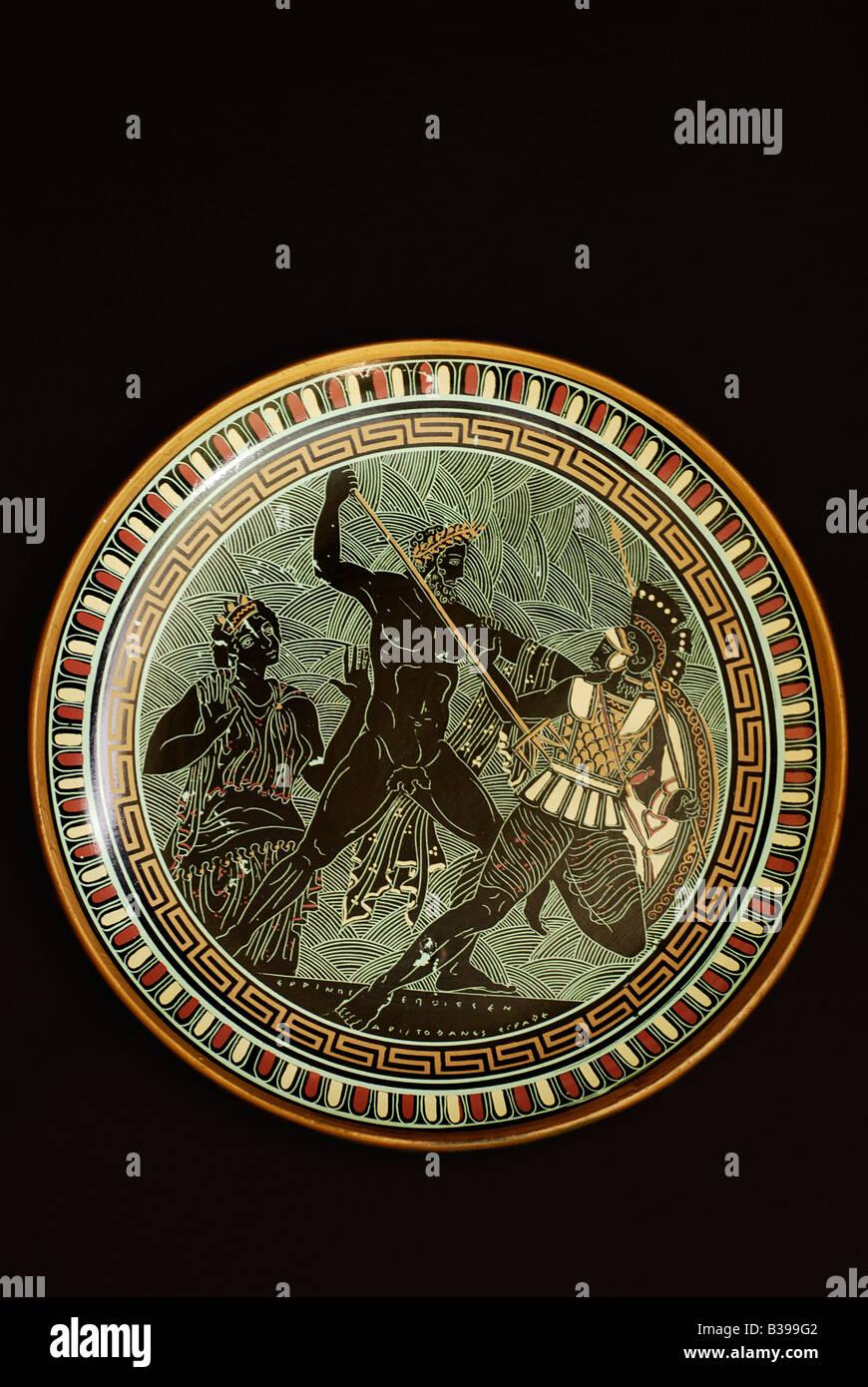 Hand made plate, Poseidon fights Polybotes - Stock Image