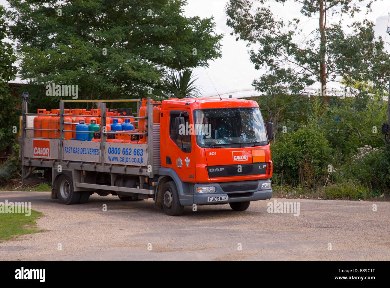 Propane and butane gas cylinders on lorry being delivered (calor) - Stock Image