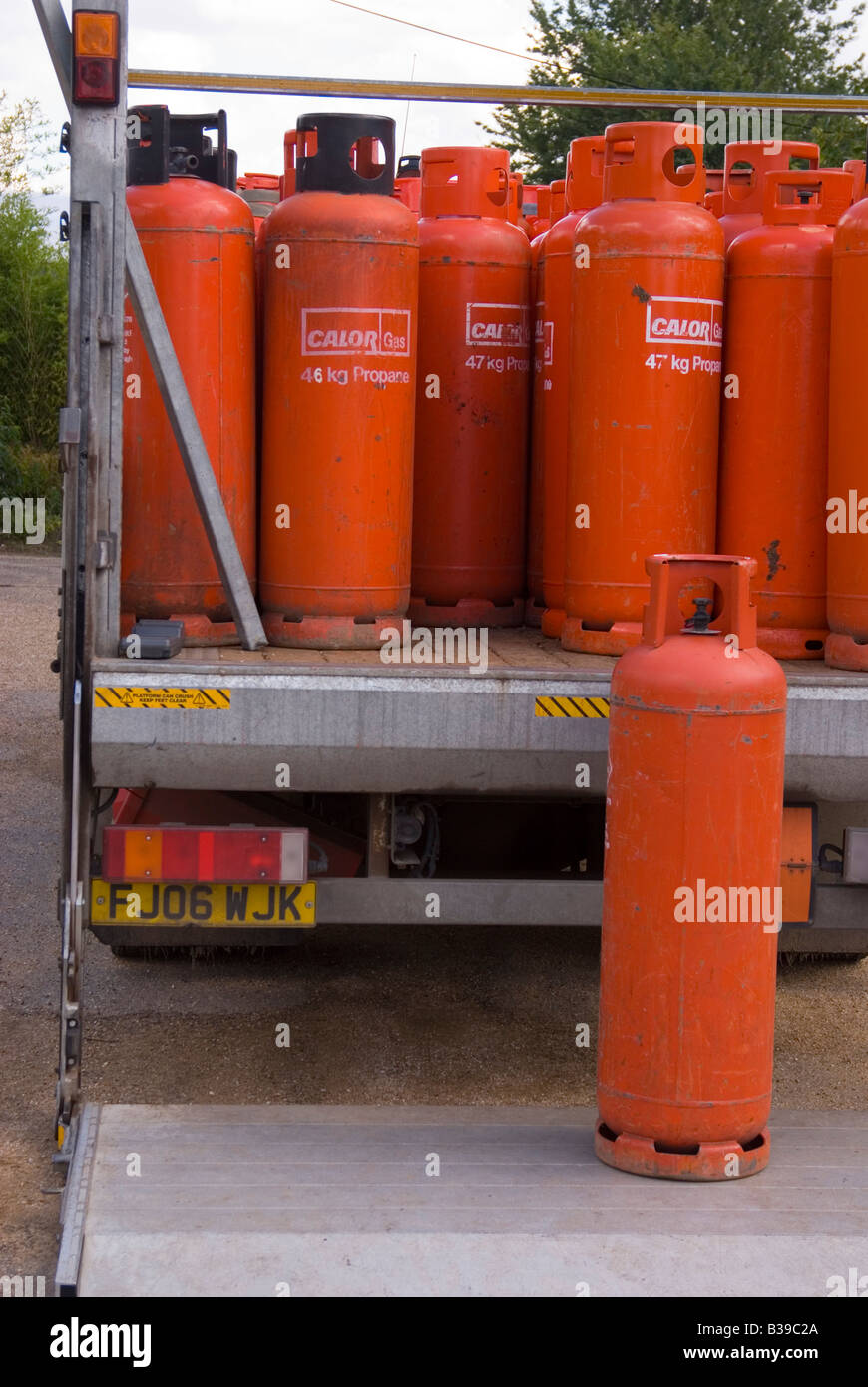 Propane gas cylinders (calor) on the back of a lorry being unloaded - Stock Image