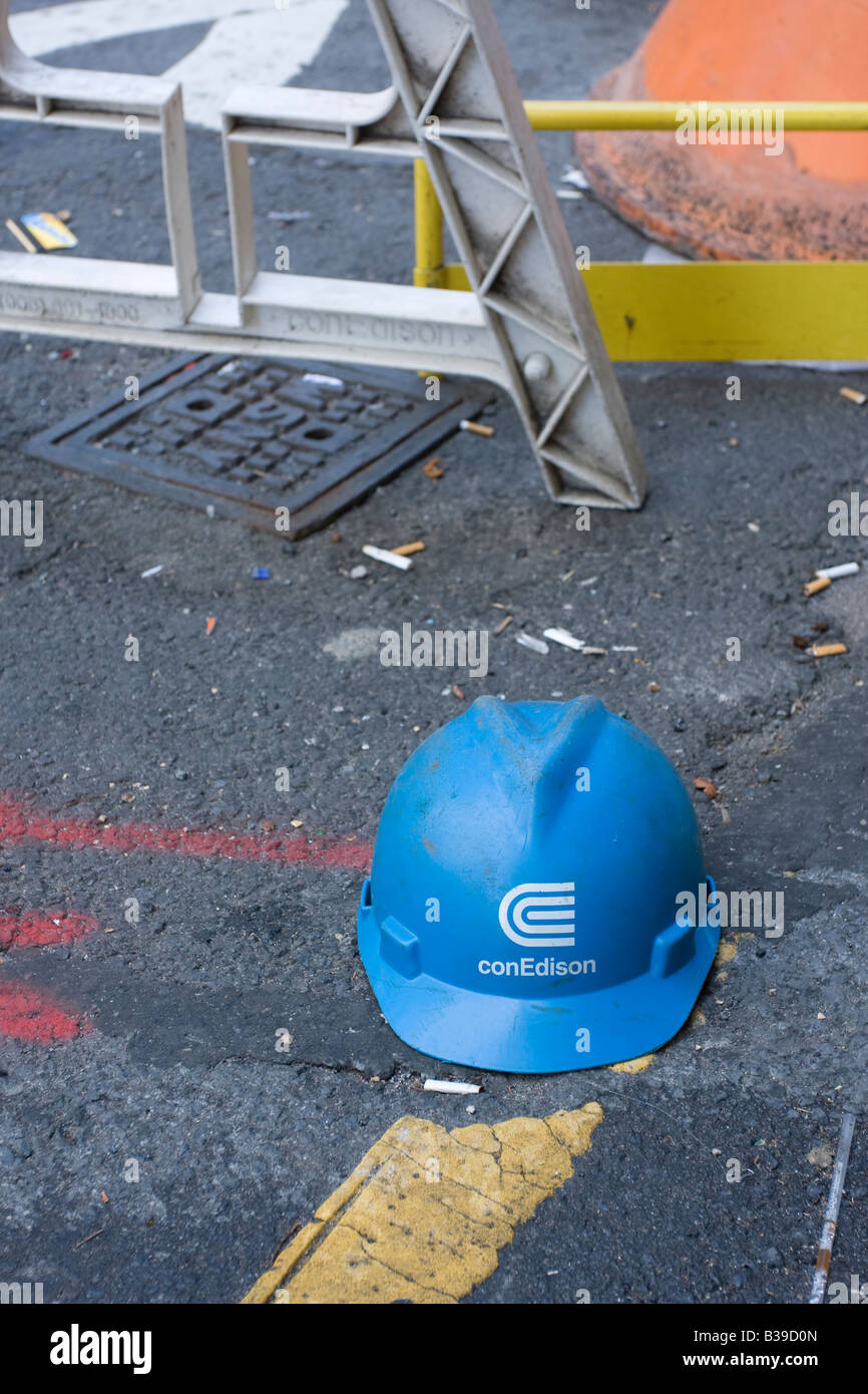 A discarded ConEdison helmet at a work site in lower Manhattan, NY. - Stock Image