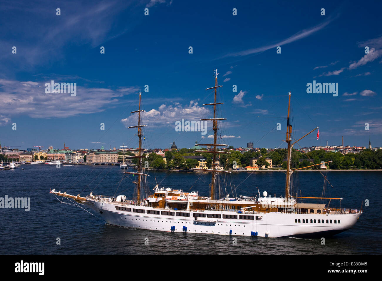 Tall sailing ship returning to Stockholm after tourist excursion on a sunny summer afternoon. - Stock Image