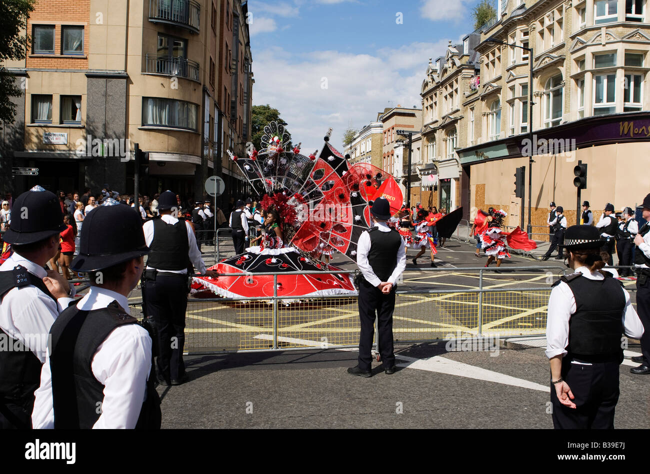 Officers of the London Metropolitain Police Force maintain a watch on the festivities during the Notting Hill Carnival - Stock Image