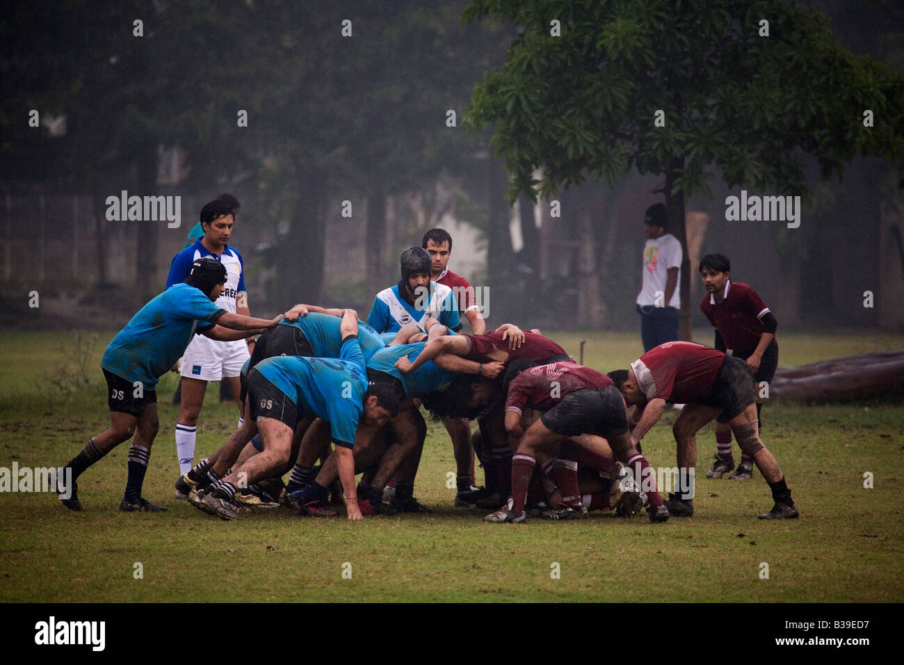A scrum is held during a rugby match in Kolkata. - Stock Image