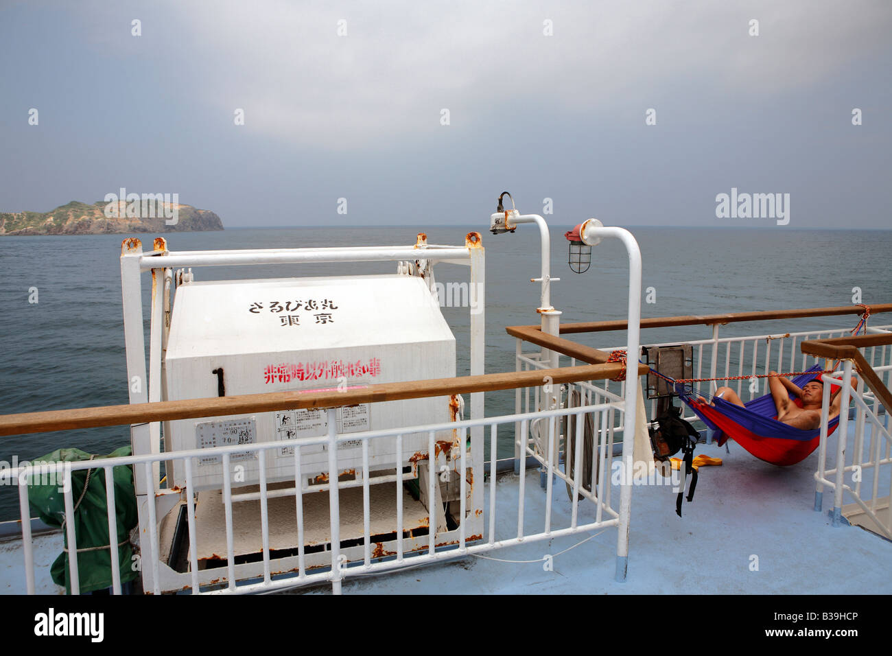 Japanese holiday makers on the ferry ferryboat to Shikinejima island - Stock Image