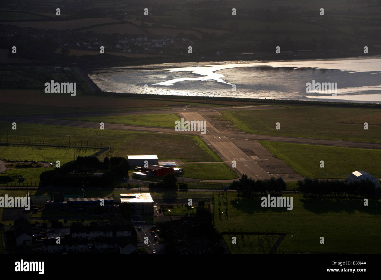 aerial view of sun rising over the airstrip at newtownards county down northern ireland - Stock Image