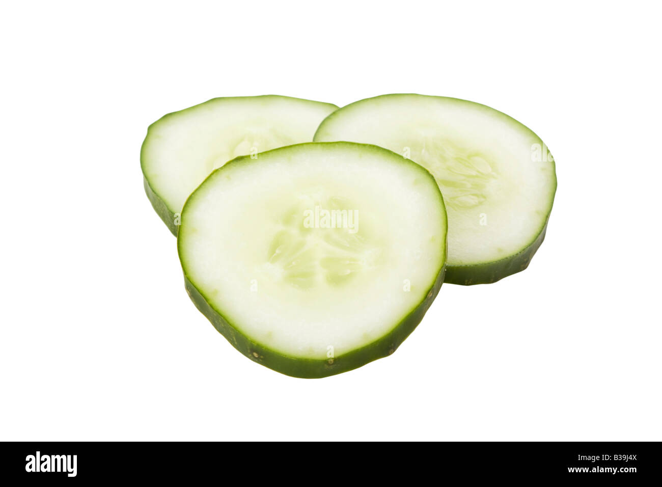 Cucumber slices isolated on a white background - Stock Image