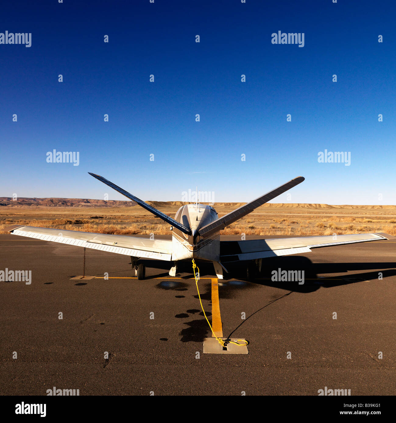 Plane parked on tarmac at Canyonlands Field Airport Utah United States - Stock Image
