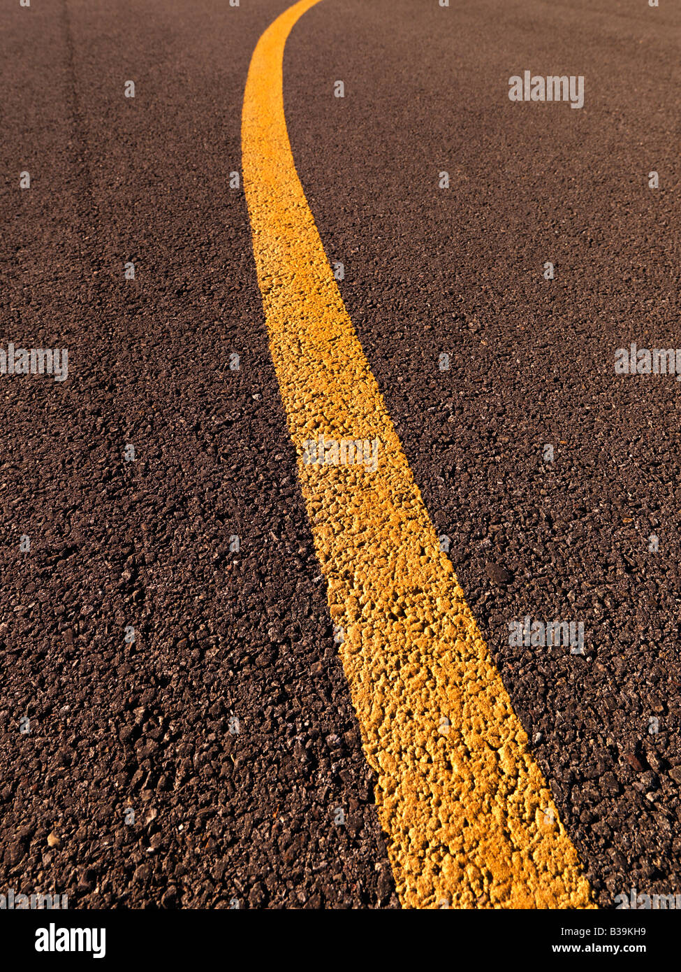 Clsoe up of yellow line on asphalt - Stock Image