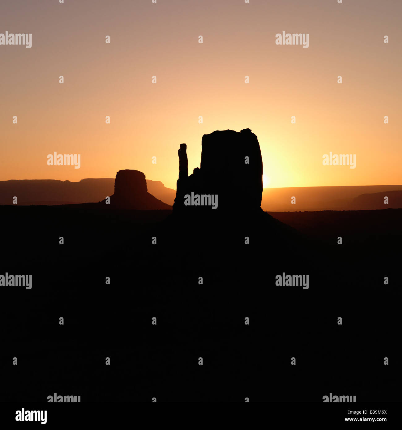 Scenic sunset landscape of mesas in Monument Valley near the border of Arizona and Utah United States - Stock Image
