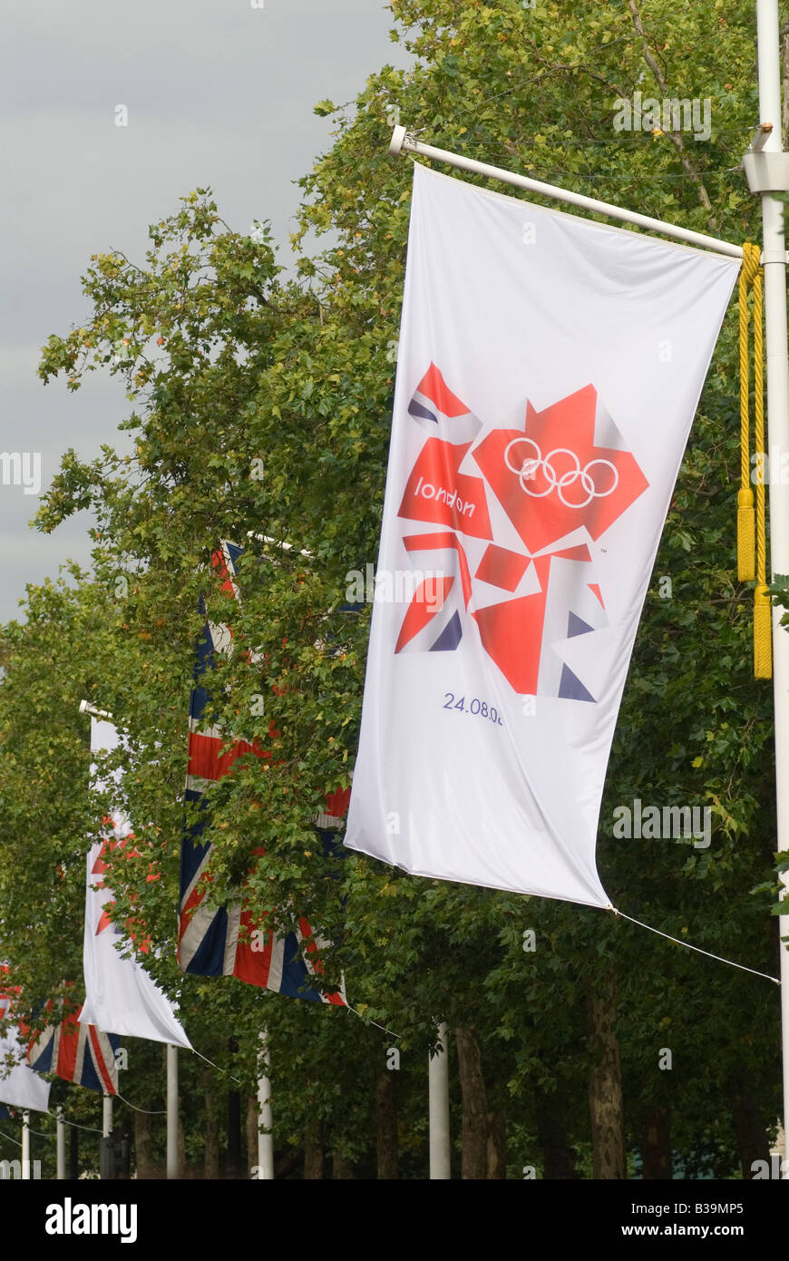 2012 London Oylmpic Games flag and Union Jack flag hanging in the Mall London England HOMER SYKES - Stock Image