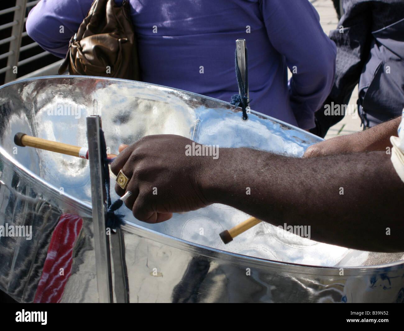 Steel Drum Player on London's Golden Jubilee Bridge - Stock Image