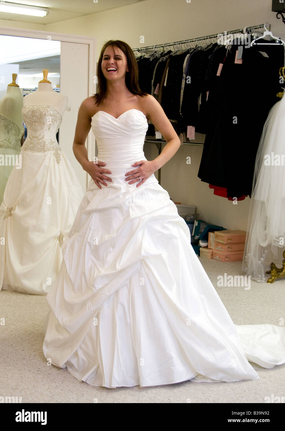 A young bride has her bridal gown fitting a few months before the wedding. - Stock Image