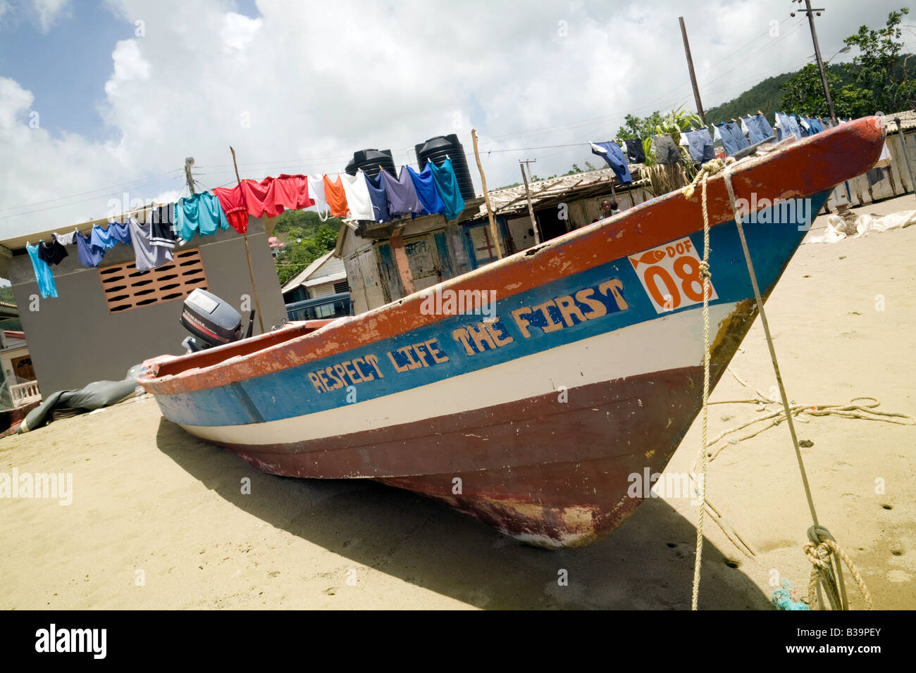 "Fishing boat and washing line on the beach, Anse la Raye, St Lucia, ""West Indies"" Stock Photo"