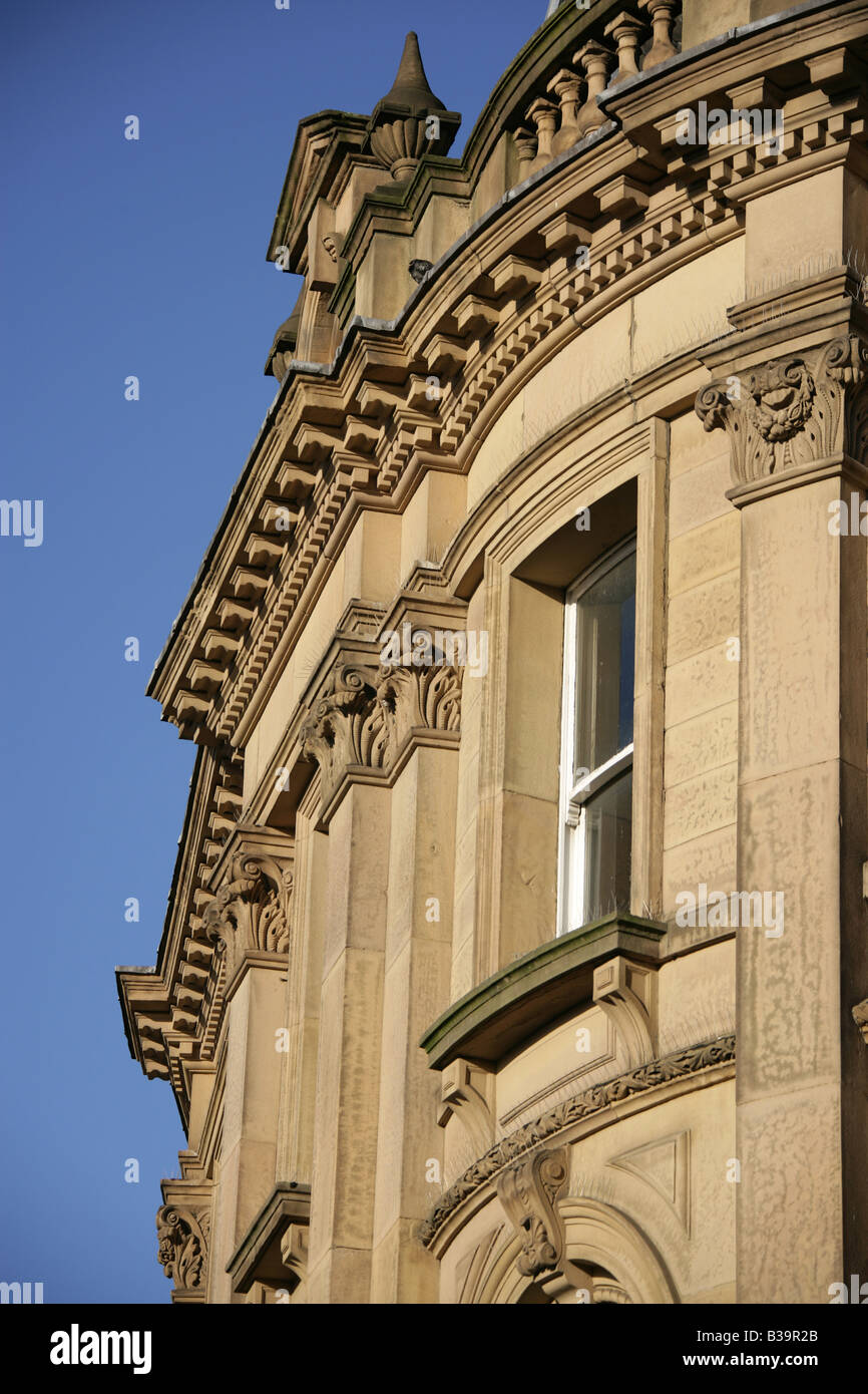 City of Derby, England. Close-up view of the architecture above the Revolutions Bar on the corner of Wardwick and - Stock Image