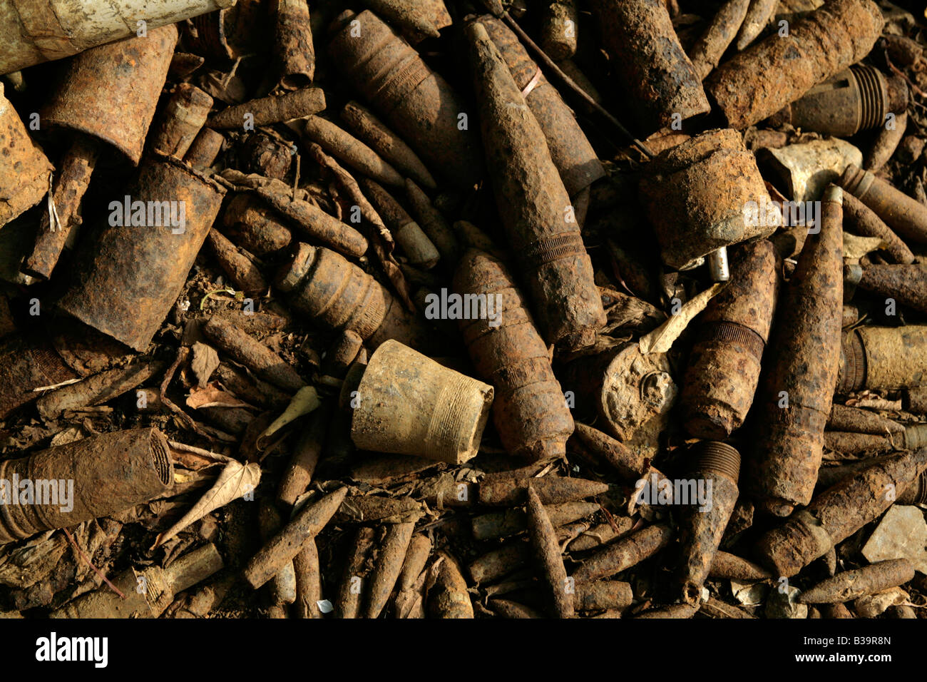 Nong Het  district, Xieng Khouang  Live munitions lie in a dangerous pile in the front driveway of a scrap dealer's - Stock Image