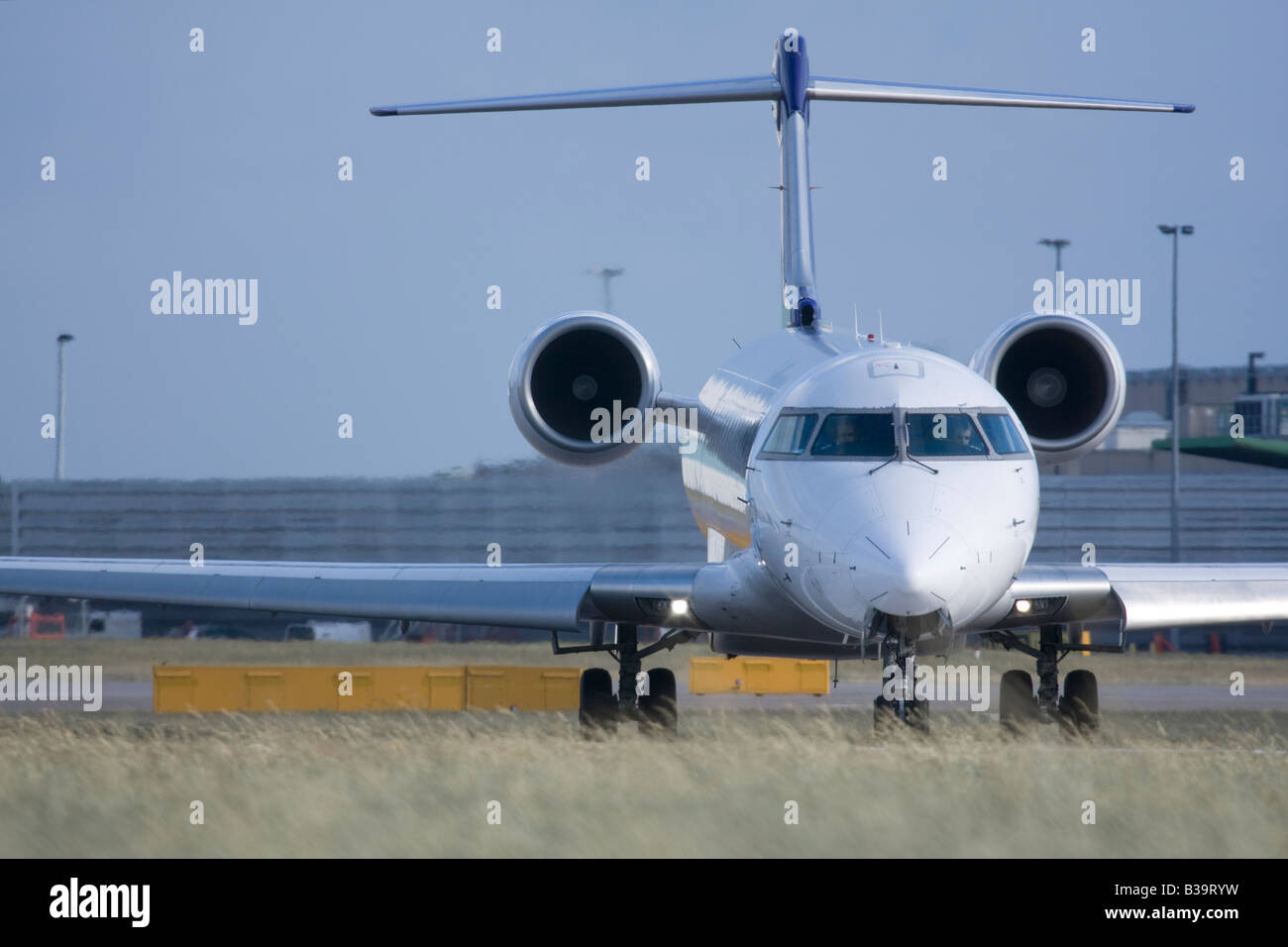 Regional jet taxiing for departure - Stock Image