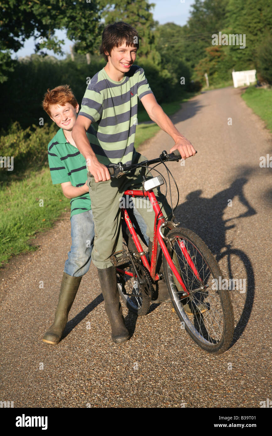 Two teenage boys on a bicycle - Stock Image
