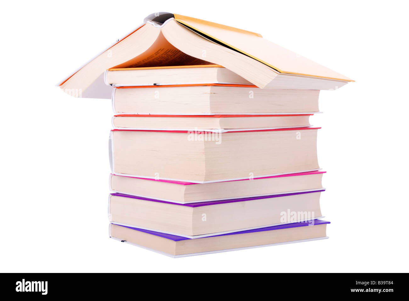 House made with books piled isolated on white background / book roof building Roof Building cut out cutout real - Stock Image