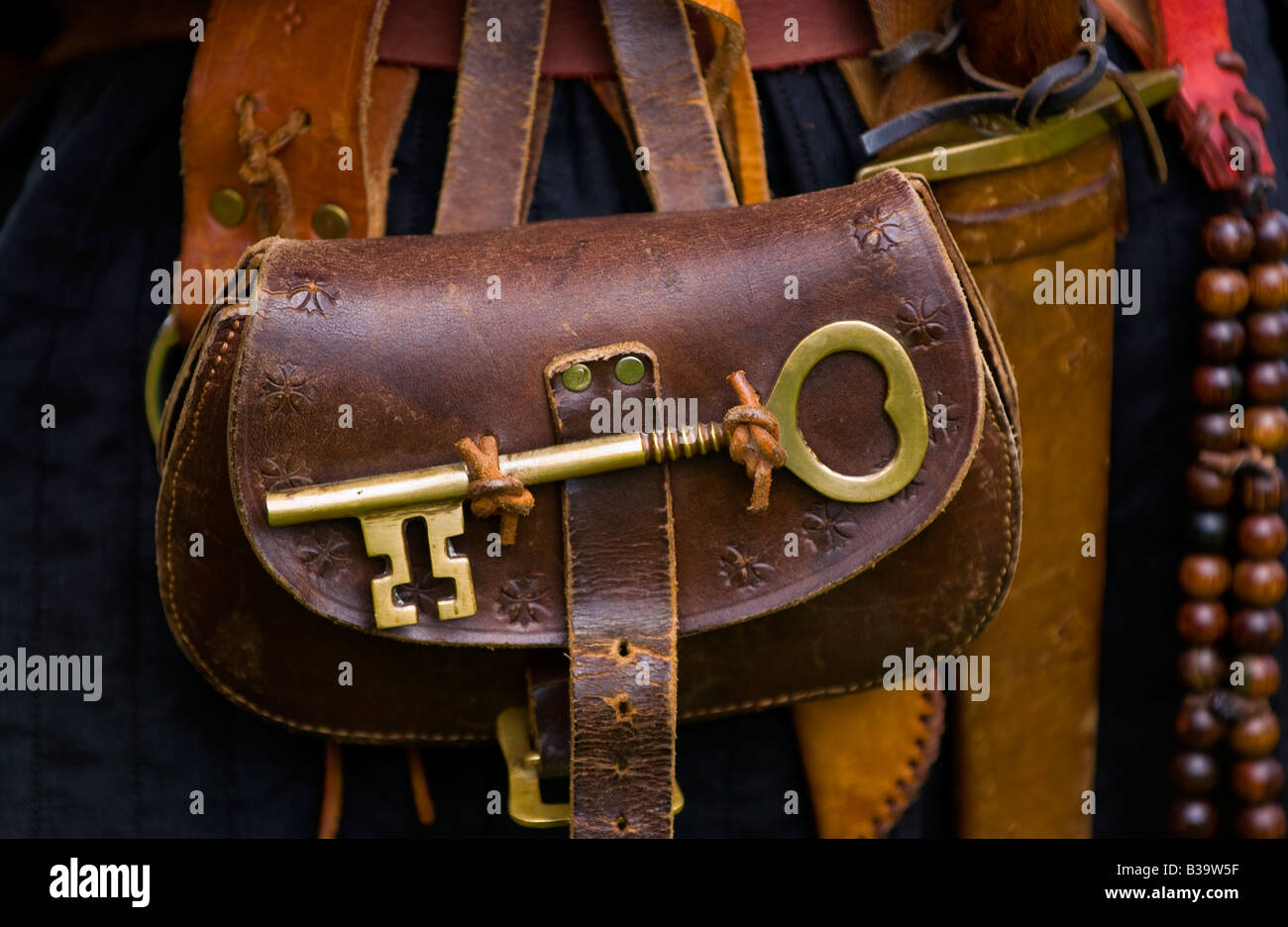 Reenactor wearing leather pouch with large brass key at Skenfrith Medieval Fun Day Monmouthshire Wales UK EU - Stock Image