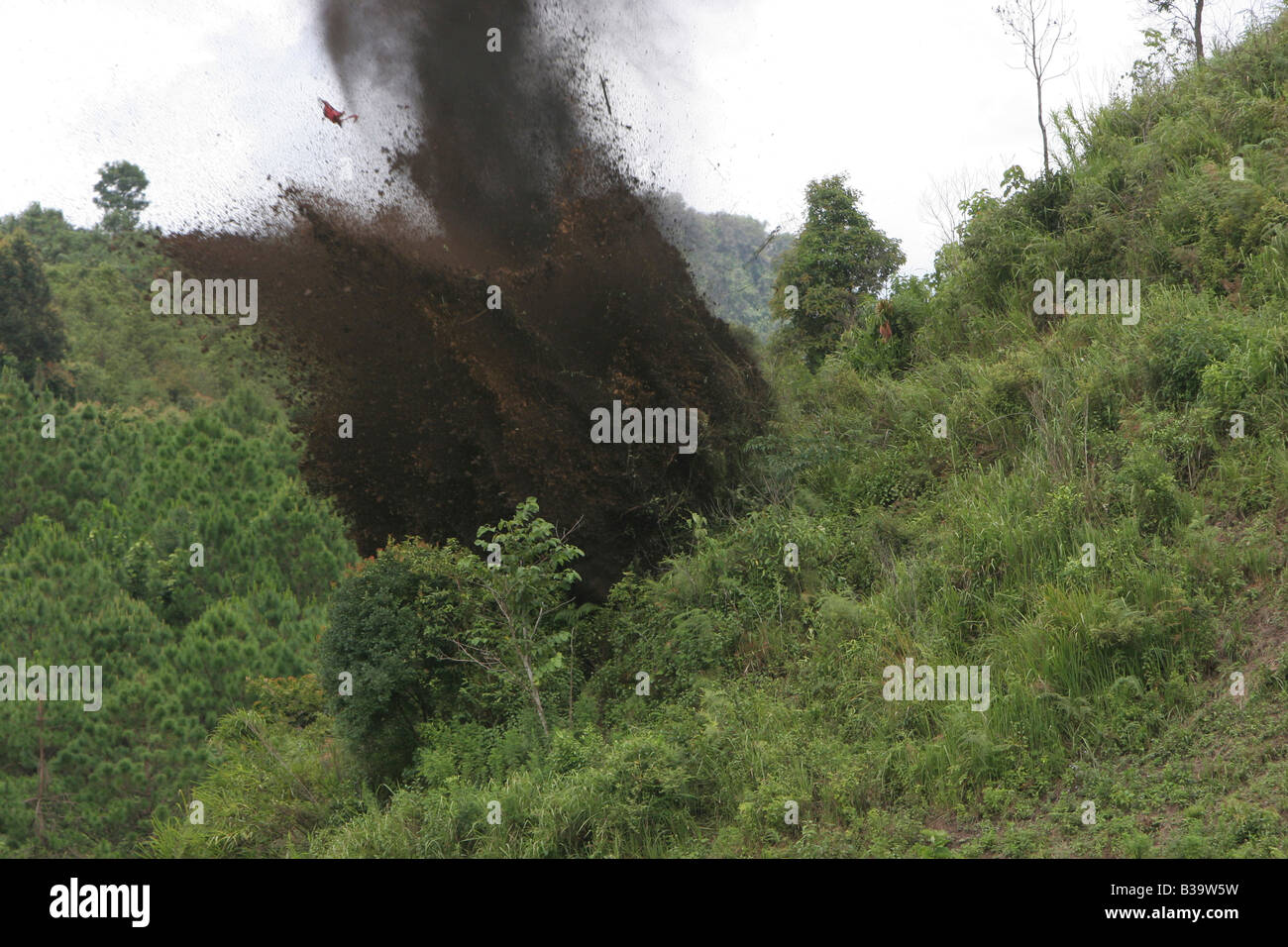 UXO Clearance,Nong Het district,Xieng Khouang province.MAG's Clearance team detonate charges of TNT to destroy - Stock Image
