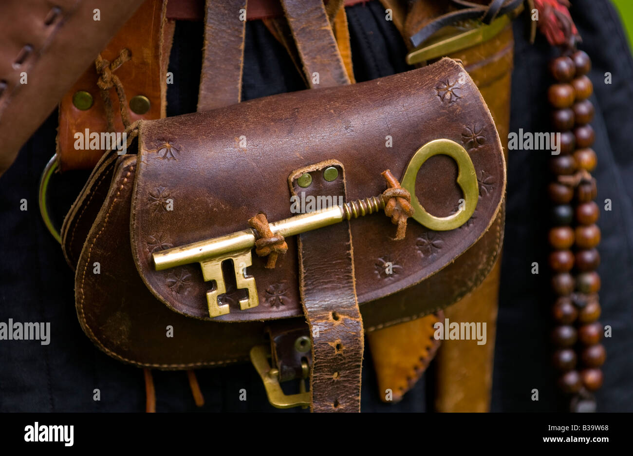 Reenactor wearing with large brass key at Skenfrith Medieval Fun Day Monmouthshire Wales UK EU - Stock Image