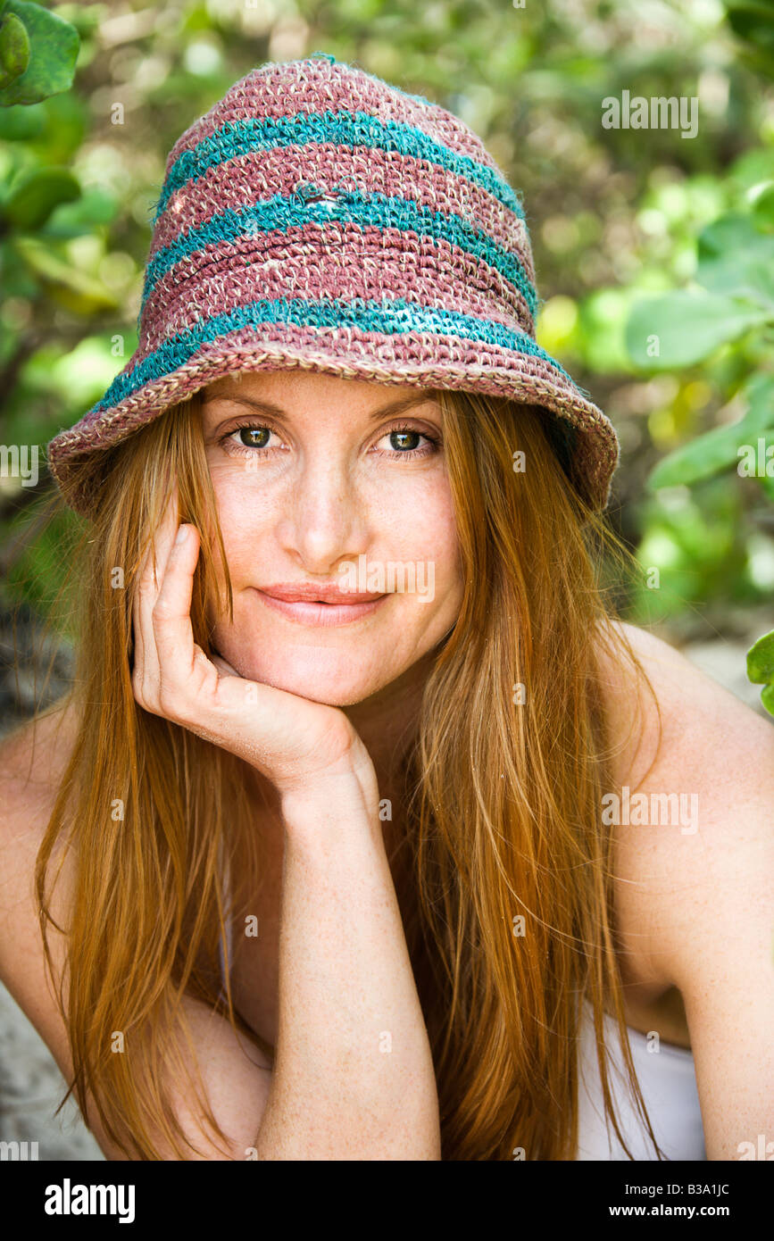 Portrait of pretty redheaded woman wearing hat - Stock Image