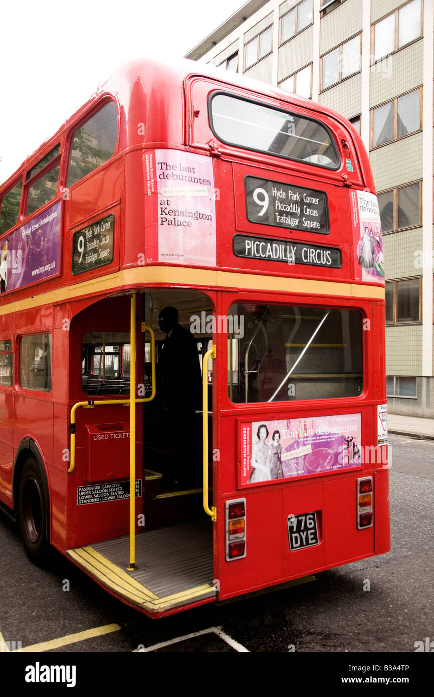 The back of a red bus in London, England. - Stock Image