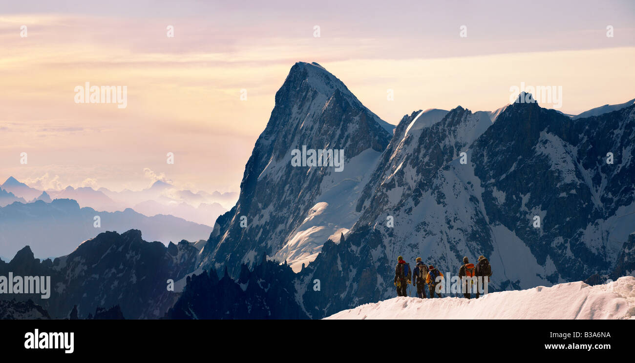 Climbers leaving Alguille du Midi for the Mont Blanc Massif, Chamonix Mont Blanc, France - Stock Image