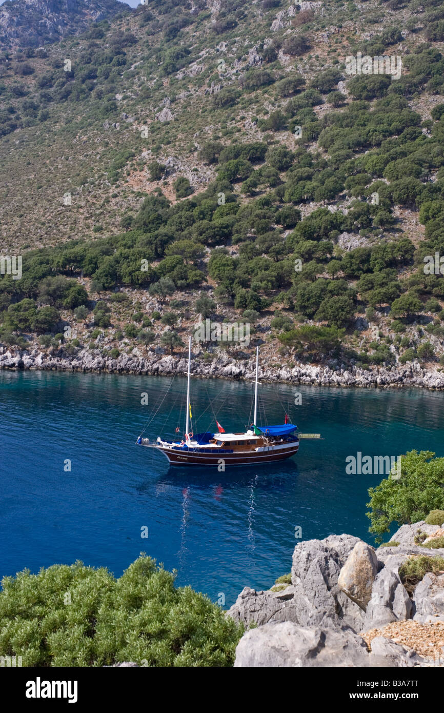 Turkey, Cove of Aga Limani, Gulet in tourquoise waters - Stock Image