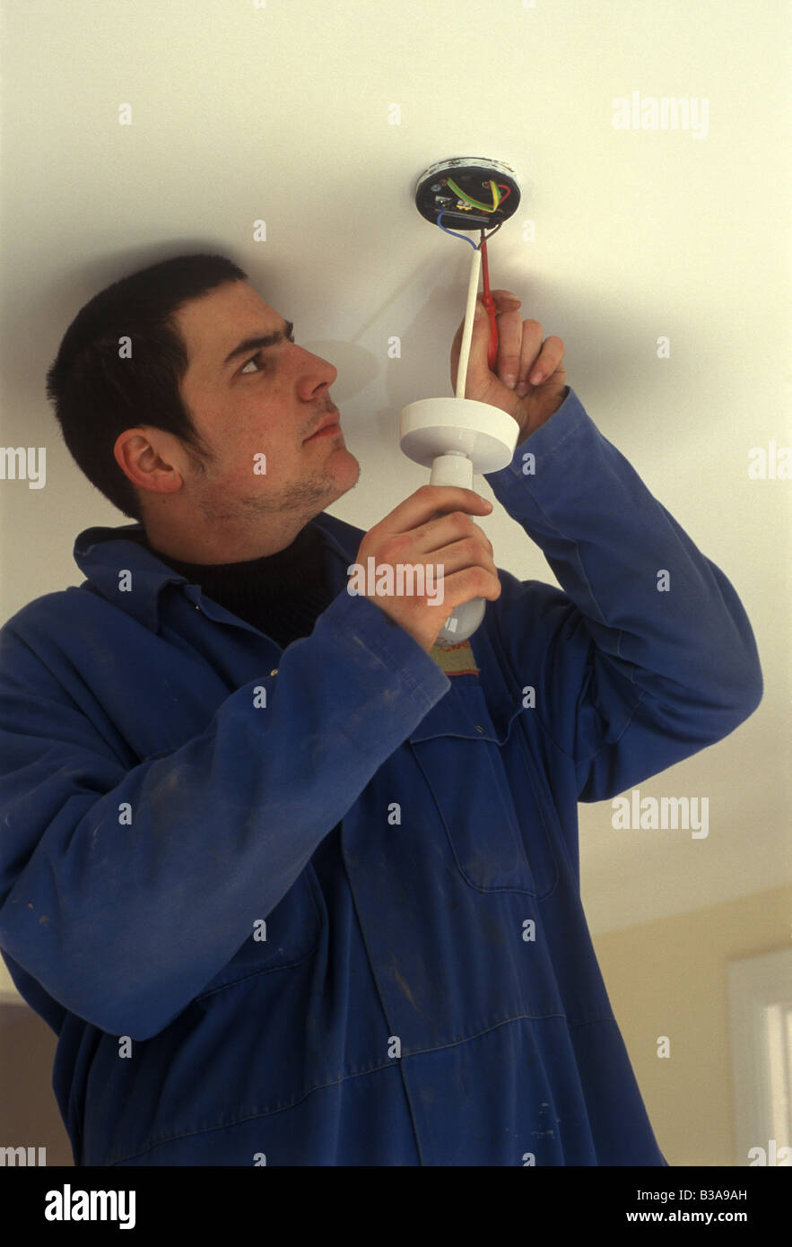 Electrician Wiring Ceiling Rose Stock Photos A In New House Image