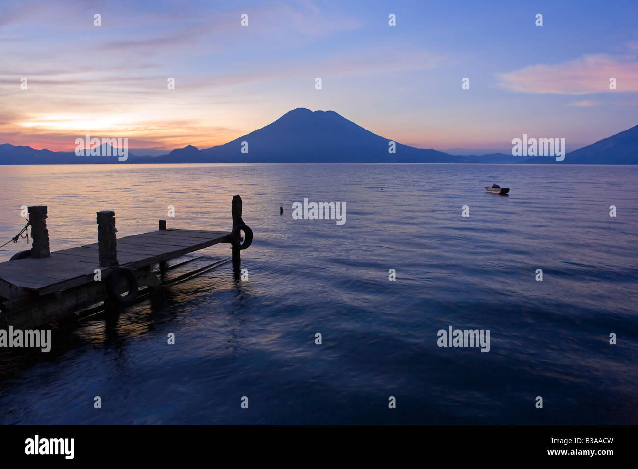 Jetty, Lake Atitlan and Volcano San Pedro, dawn, Guatemala - Stock Image