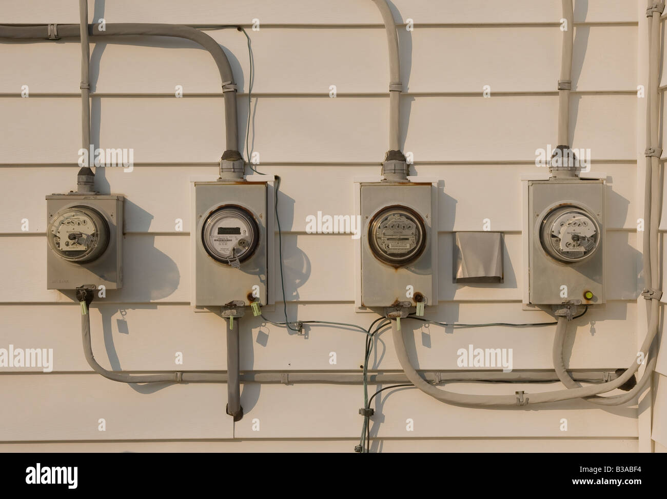 Electrical meters attached to a building - Stock Image