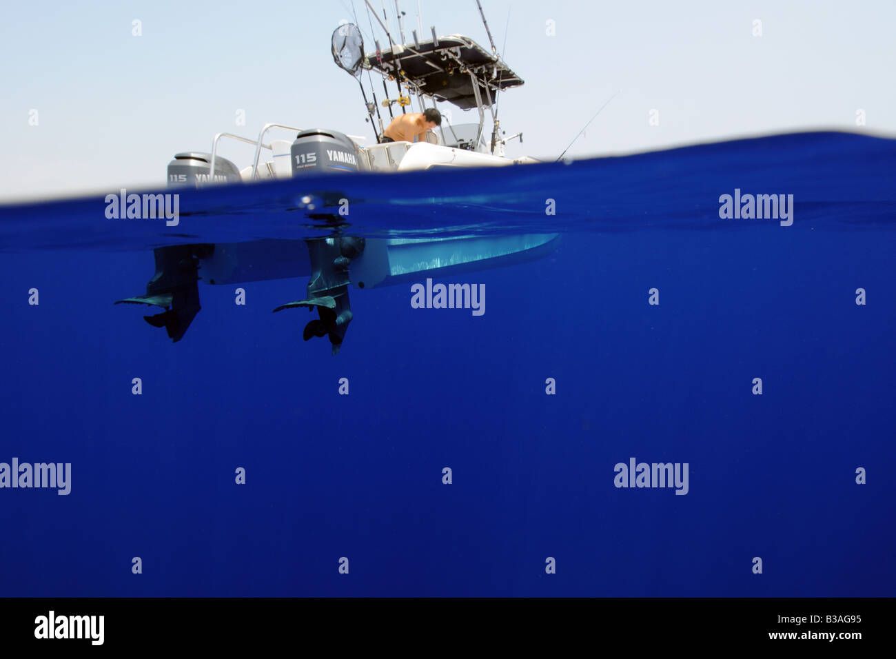 Split image of 21 feet catamaran in open ocean Kailua Kona Hawaii - Stock Image