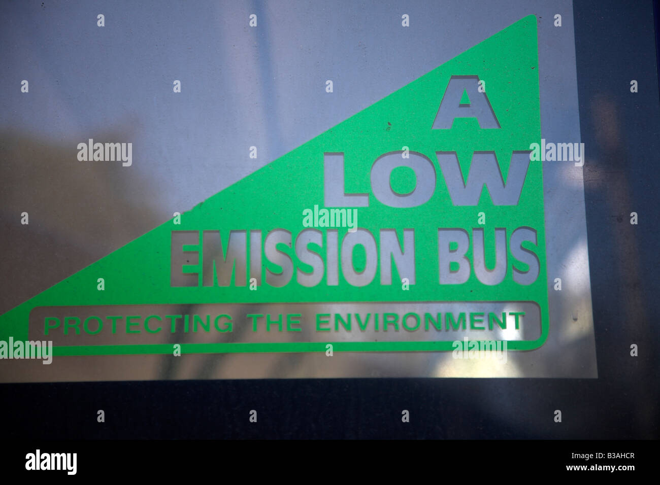 A low emission bus sign in back windscreen glass - Stock Image