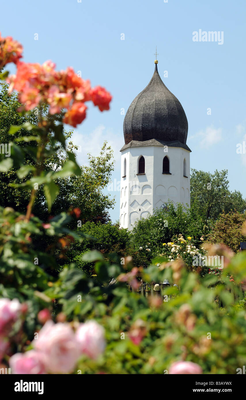 The bell tower of Frauenchiemsee island is a very well known landmark in the Chiemsee Stock Photo