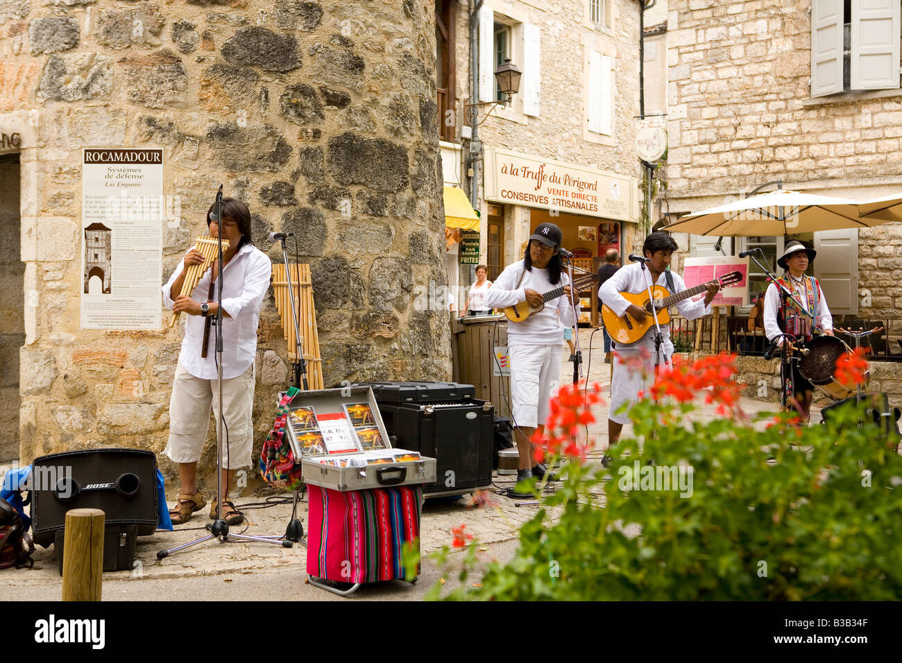 South American musicians playing panpipes and guitars in the mediavel town of Rocamadour in the Lot region of France Stock Photo