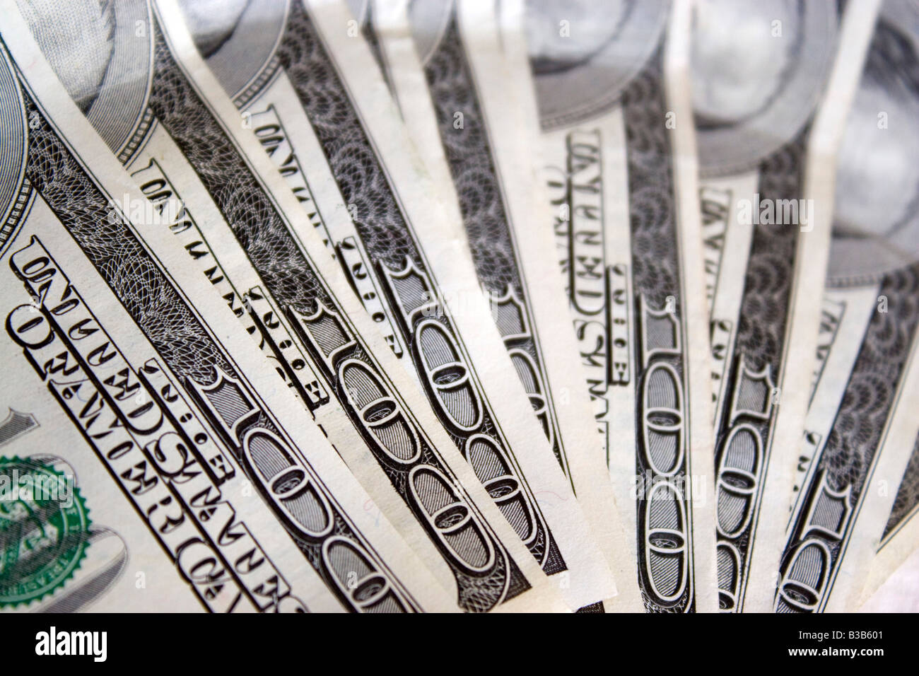 A macro shot of some cold hard cash fanned out - Stock Image