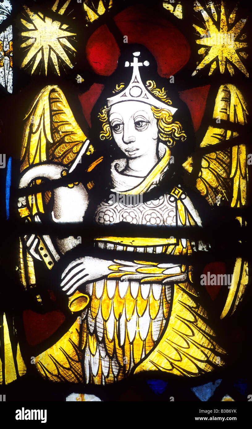 Winged Angel musician music musical instrument minstrel playing bagpipes Medieval stained glass Norwich Guildhall - Stock Image