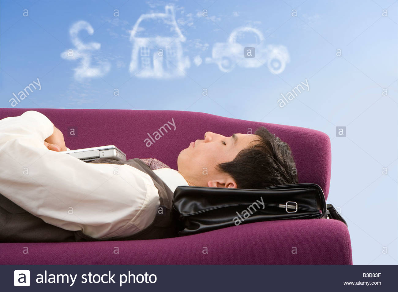 Businessman daydreaming about success - Stock Image