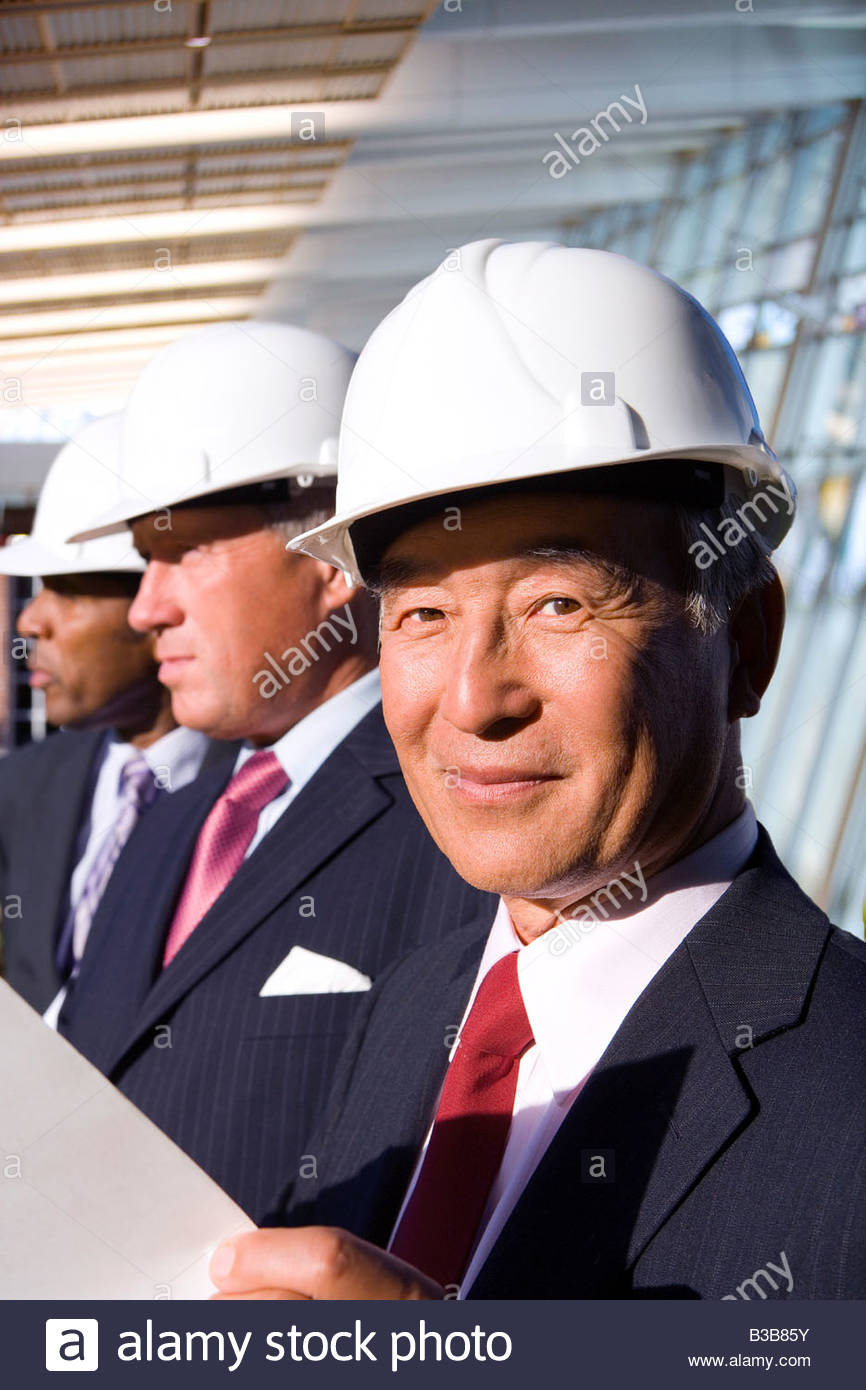 Businessmen inspecting construction site - Stock Image