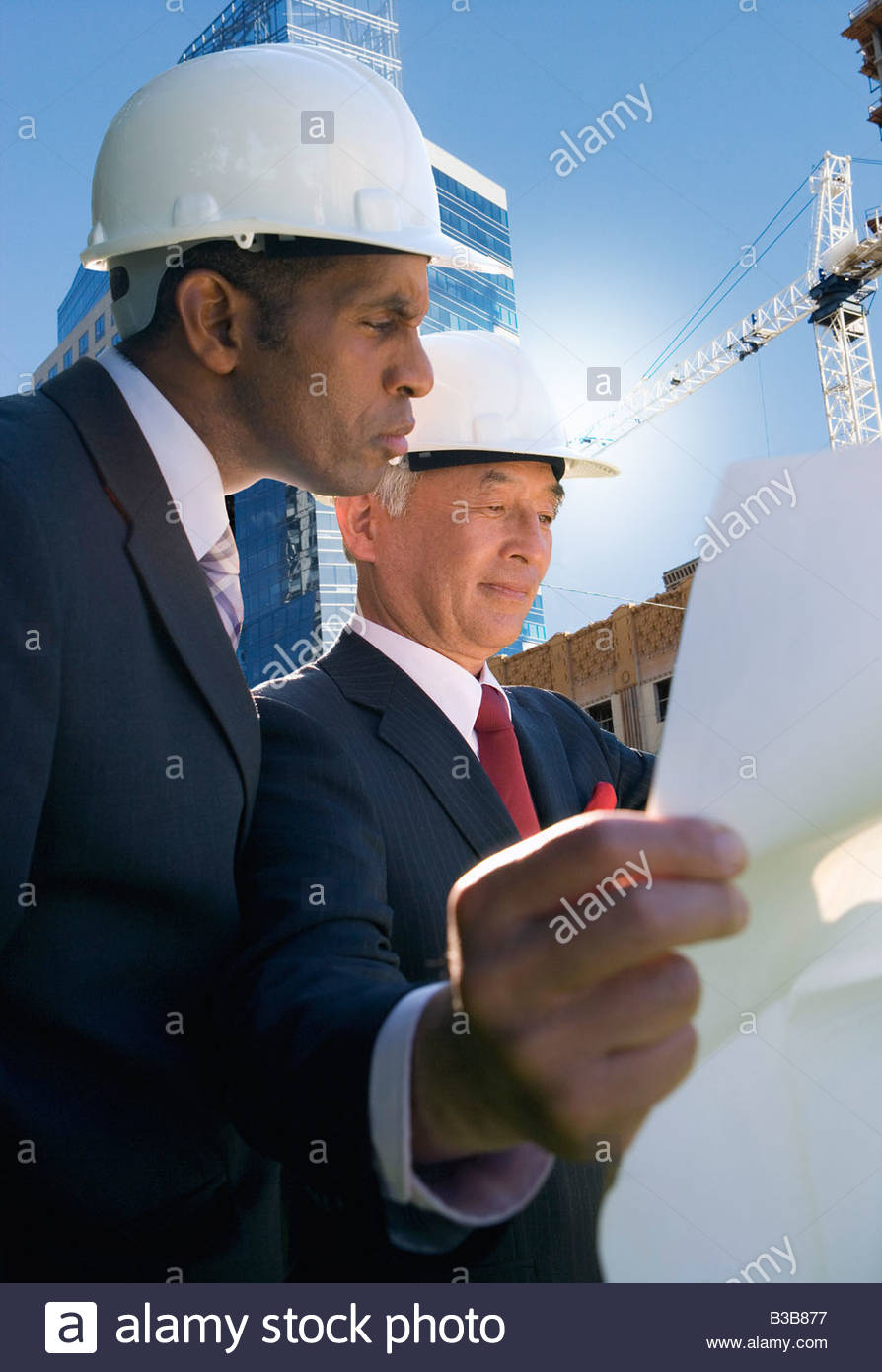 Businessman inspecting construction site - Stock Image