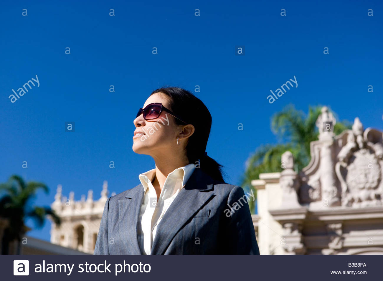 Businesswoman standing near historic building - Stock Image