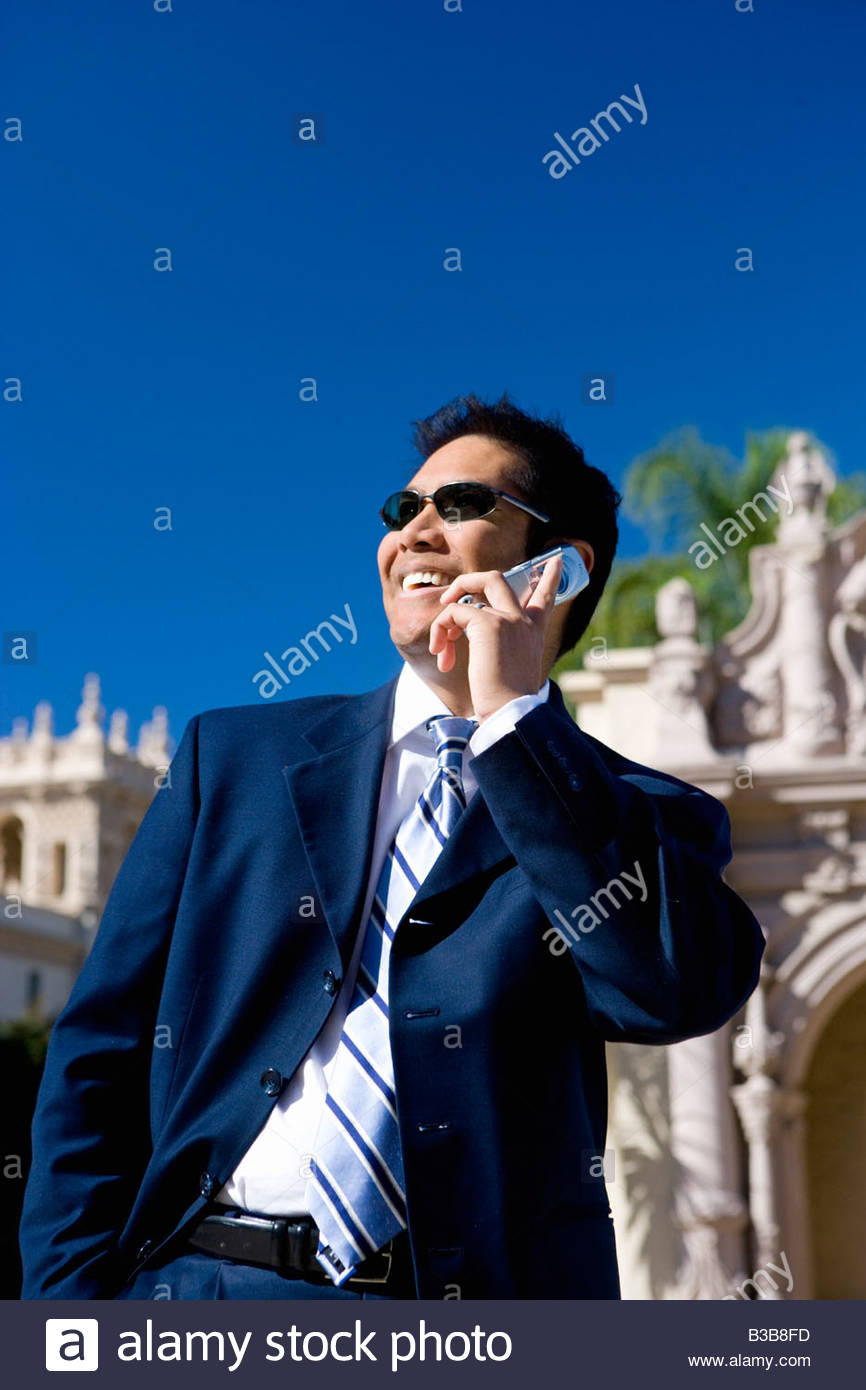 Businessman standing near historic building - Stock Image