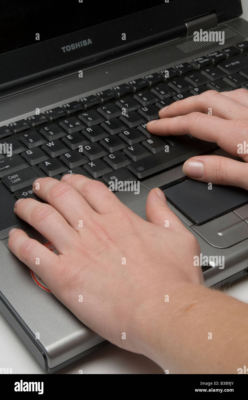 hands hand on laptop computer pc wifi wi fi wireless internet connection pc it type typing tap tapping fingers reporter - Stock Image