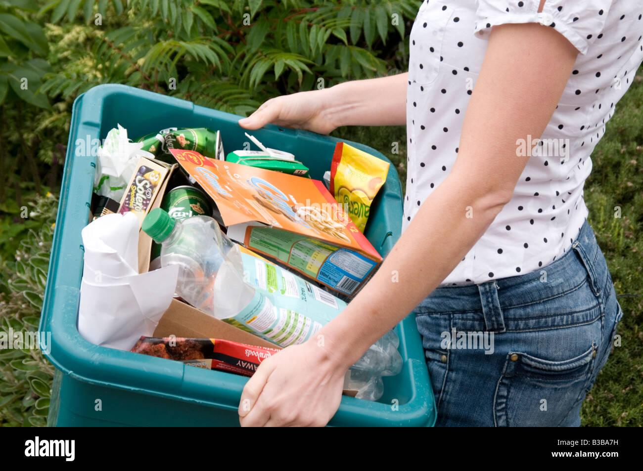 recycle recycling kerbside kerb side green box bin trash rubbish bin reusable taking out the bins boxes - Stock Image
