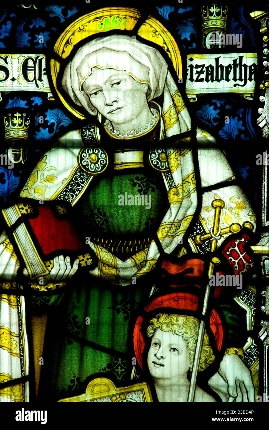 St.Elizabeth and the child Jesus depiced in the stained glass of the 13th century St.George church Woolhope Herefordshire Stock Photo